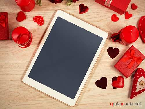 Tablet Surrounded by Valentine's Day Elements 246885760