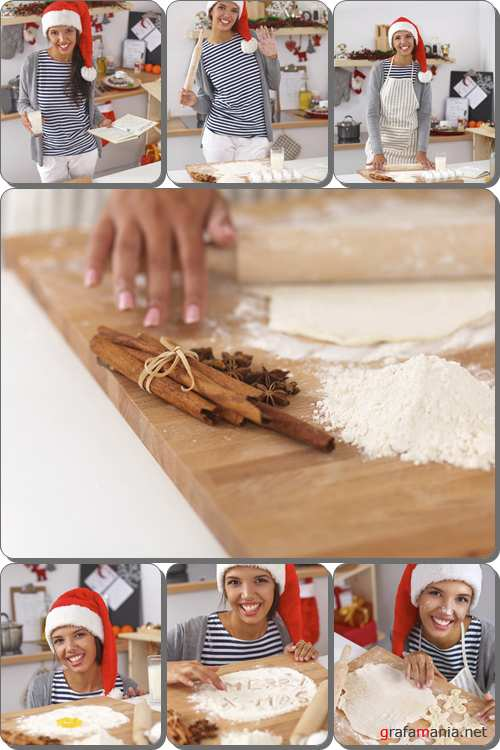 Happy young woman smiling happy making christmas cookies in the kitchen - Stock photo